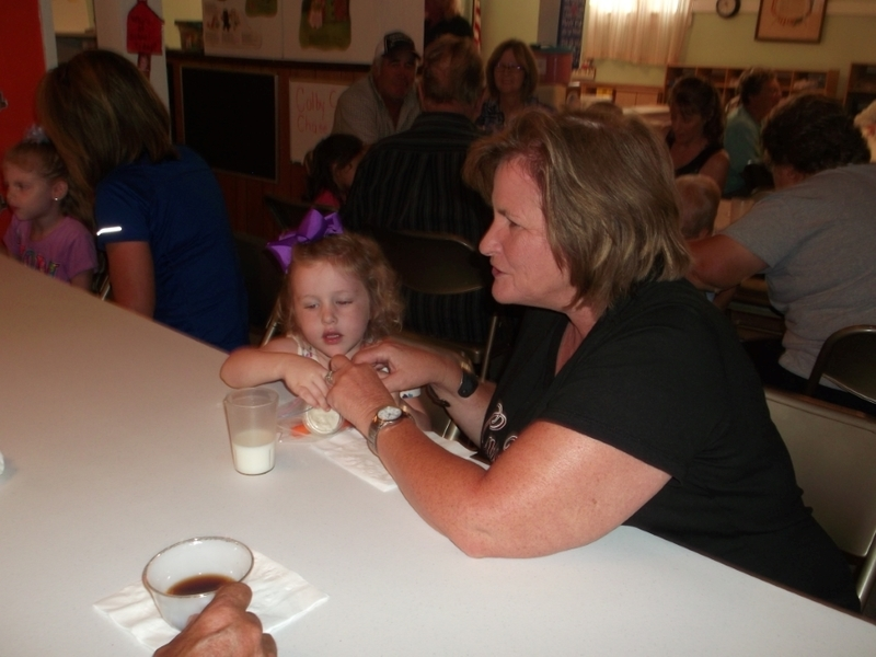Parent and student enjoying brownie.