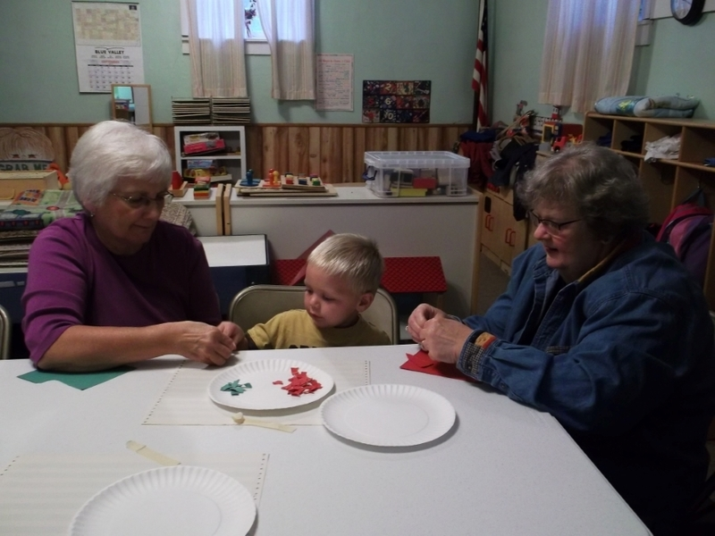 Preschool AM class doing arts and crafts with their families